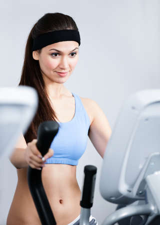 Young woman training on gym training in gym photo