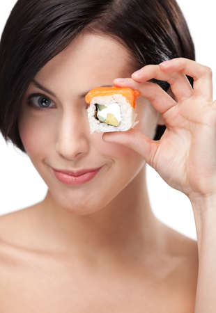 Young girl holding sushi in her hand, isolated on white photo