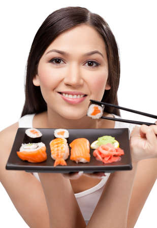 gladly: Brunette attractive girl holding sushi with a chopsticks, isolated on white