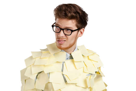 Young man with a glasses covered with yellow sticky notes, isolated on white background photo