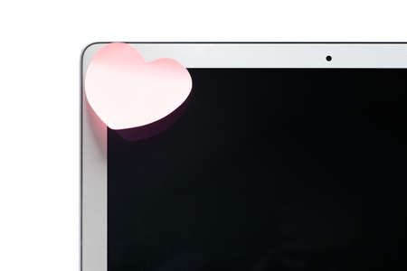 assert: Laptop with a sticker in the shape of a heart