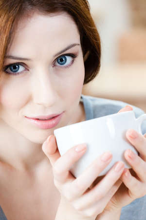 vertical bars: Woman with cup of tea has a rest at the cafeteria Stock Photo