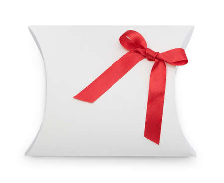 Fancy gift-box with red ribbon, isolated on white. Symbol of party and happy holiday photo