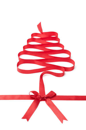 The spiral ribbon looks as Christmas tree, isolated on white. Symbol of party and happy holiday photo