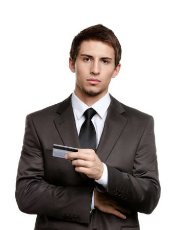 credit crisis: Upset businessman with credit card, isolated on white Stock Photo