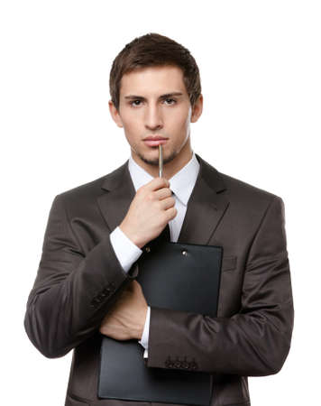 Pensive businessman holds black paper folder and pen, isolated on white Stock Photo - 17824376