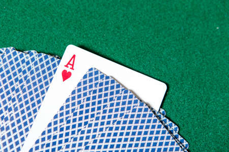 Back of the playing cards and ace of hearts. Risky entertainment of gambling Stock Photo - 17822574