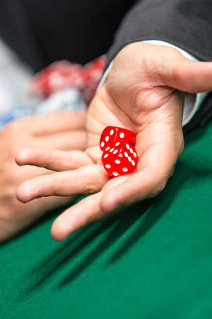 throws: Player throws dices on the poker table. Challenge to the casino