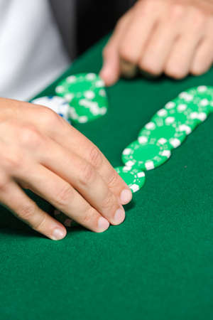 Gambler puts the chips on the table. Challenge to the casino photo