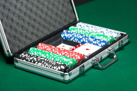 Poker set in metal suitcase. Challenge to the casino photo