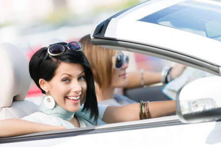 street shots: Female friends driving white car and having fun on the vacation