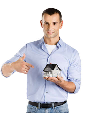 Real estate agent hands small model house, isolated on white photo