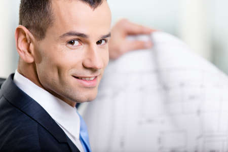 architecting: Close up of business man with draft. Concept of successful construction Stock Photo
