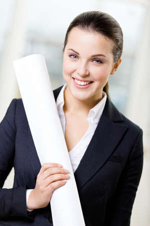 architecting: Female engineer wearing suit hands layout