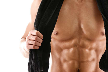 male torso: Sexy body of muscular athletic man with black towel, isolated on white