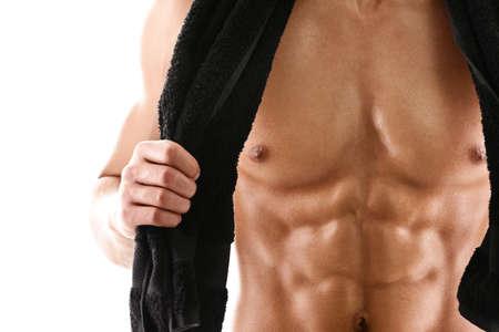abdomen fitness: Sexy cuerpo de hombre musculoso con la toalla atl�tico negro, aislado en blanco