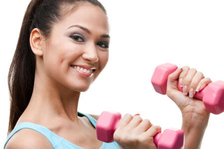 Athletic young woman exercises with pink dumbbells, isolated on white Stock Photo - 17824378