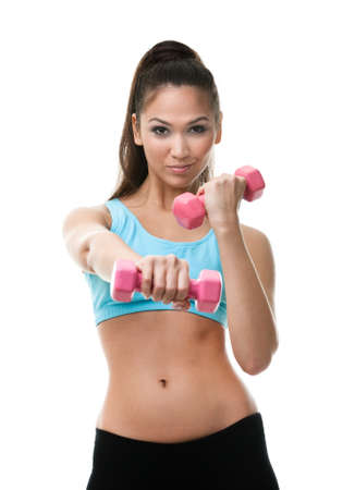 sporting activity: Sportive woman works out with pink dumbbells, isolated on white Stock Photo
