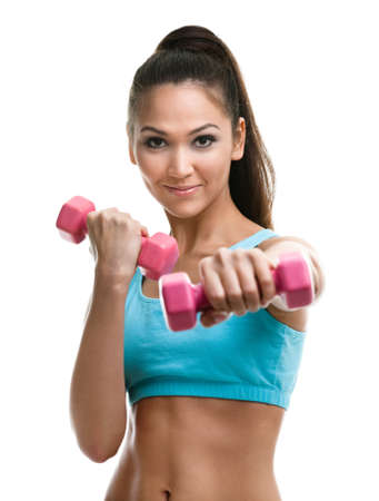 sports wear: Athletic young woman works out with pink dumbbells, isolated on white