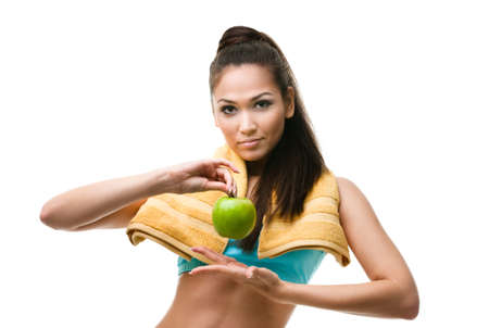 Sporty woman hands ripe green apple, isolated on white photo