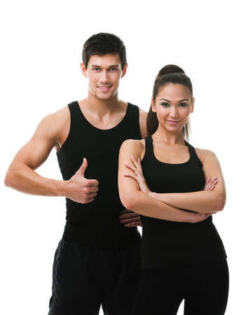 Two sportive people in black sports wear, isolated on white photo