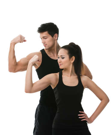 half body: Two sportive people in black sportswear showing their biceps, isolated on white background