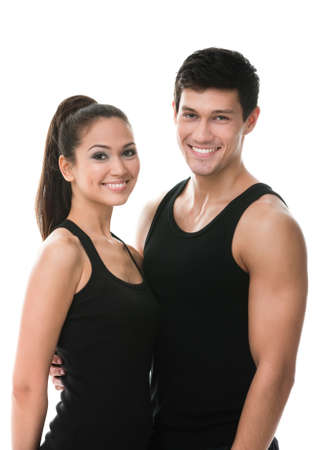 half body: Two sportive people in black sportswear embrace each other, isolated on white