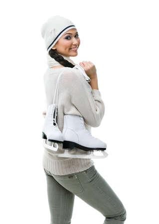 Female figure skater hands skates on her shoulder, isolated on white Stock Photo - 17824256
