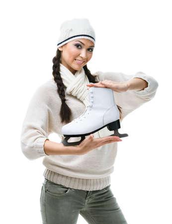 Female figure skater hands one skate, isolated on white Stock Photo - 17824299