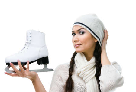 Female figure skater pensively looks at the skate, isolated on white Stock Photo - 17824284
