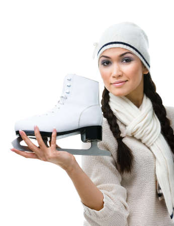 Pretty female figure skater shows one skate in hand, isolated on white Stock Photo - 17824512