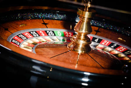 Close up of wooden roulette at the gambling house photo