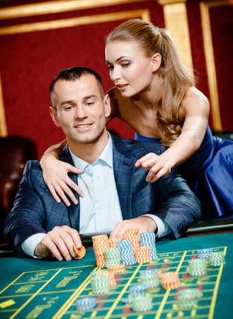 Girl advises gambler a safe bet. Risky entertainment of gambling photo