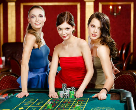 roulette: Three women place a bet playing roulette at the casino