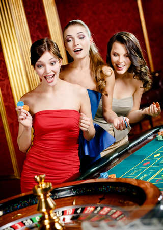 roulette player: Three women playing roulette at the casino