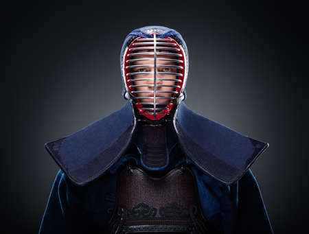kendo: Portrait of kendo fighter in traditional armor