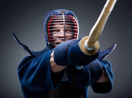 kendo: Close up of kendoka training with shinai. Concept of Asian martial arts