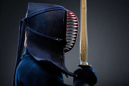 Profile of kendo fighter with shinai. Japanese martial art of sword fighting photo