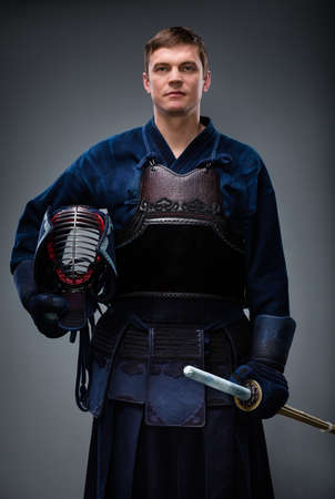 kendo: Kendoka with helmet and shinai in hands. Japanese martial art of sword fighting