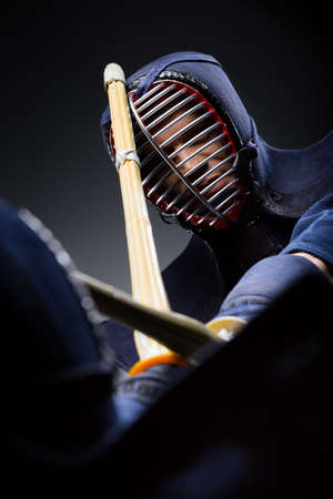 Close up shot of competition of two kendo fighters. Japanese martial art of sword fighting photo