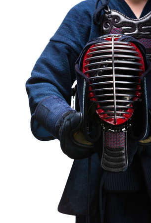 kendo: Close up of kendo helmet in hands of kendoka, isolated on white. Japanese martial art of sword fighting