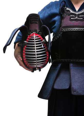 Close up of kendo helmet in hands of kendo fighter, isolated on white. Japanese martial art of sword fighting photo
