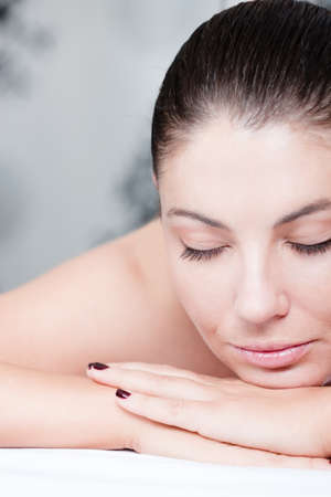 shut down: Part of face of calm female during luxurious procedure of massage at spa salon