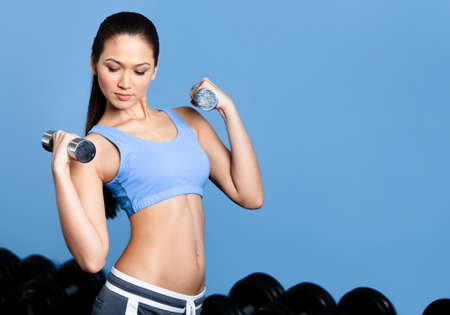 Athlete woman works out with dumbbells in gym class Stock Photo - 17824329