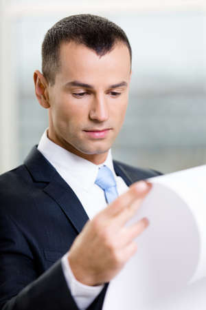 architecting: Close up of businessman with draft. Concept of successful construction