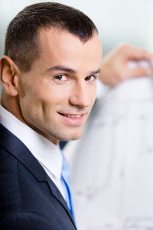 Close up of businessman with blueprint. Concept of successful construction Stock Photo - 18099894