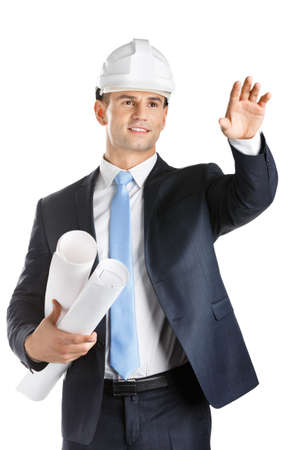 Engineer in hard hat keeps blueprints and waves hand, isolated on white. Concept of successful construction photo
