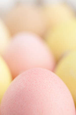 chucky: Many-colored eggs are in the cardboard box for egg delivering Stock Photo