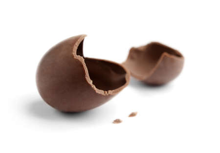 the feast of the passover: Cracked chocolate egg, isolated on white Stock Photo