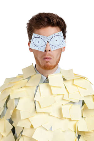 Young man with eyes painted on stickers, covered with yellow sticky notes photo